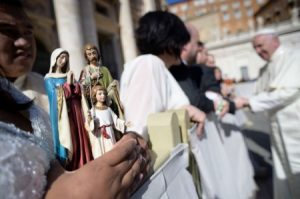 A statue of the Holy Family is held during a General Audience with Pope Francis.