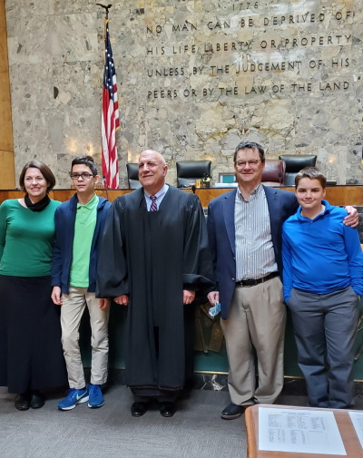 The Anater family celebrates the adoption of their son, Sam, on April 21 of this year. From left are Mary and Sam Anater, the Hon. Judge John Cherry, and Tom and Max Anater.