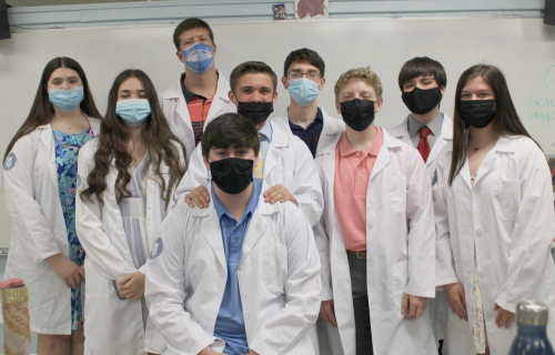 Graduates of Lourdes' Biomedical program proudly wear the lab coats presented to them during a ceremony this spring.