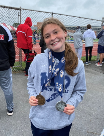 Lindsey Husic of Bishop McDevitt displays her state track and field medals for a fourth-place finish in the Class 3A girls' 4x100 relay and a second-place finish in the long jump.