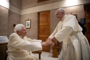 Pope Francis greets Pope Benedict XVI at the Vatican's Mater Ecclesiae Monastery on Nov. 28, 2020. (Vatican Media)