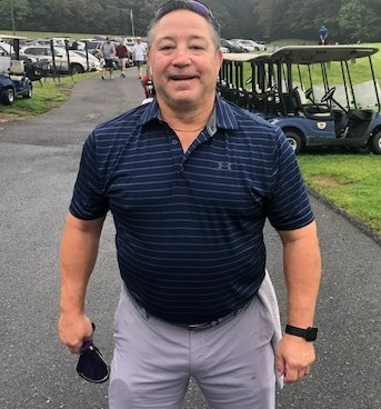 American Hockey League Hall of Famer, former Hershey Bear and Pittsburgh Penguin player Mitch Lamoureux smiled for the camera prior to getting out on the course.