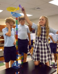 Clare Marble and several of her classmates explore the new S.T.R.E.A.M Lab at Seven Sorrows of the Blessed Virgin Mary school.