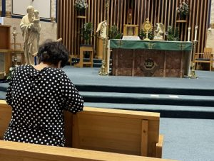 Seven Sisters member Tam Vo prays a holy hour for her pastor, Father Robert Gillelan, at the Assumption of the Blessed Virgin Mary Parish in Lebanon.